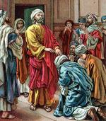 Paul laying hands in Ephesus