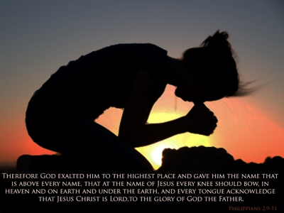 """Woman kneeling: """"at the name of Jesus every knee should bow, in heaven and on earth and under the earth"""""""