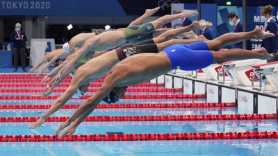 Swimmers striving for a gold medal in the men's 200-meter freestyle